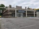 V budově bývalého Alberta bude velkoobchod, na parkovišti vyroste bytový dům
